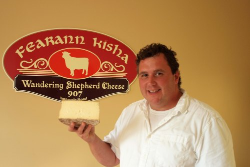 Ron Muise of Wandering Sheperd holding Lauchies Tomme