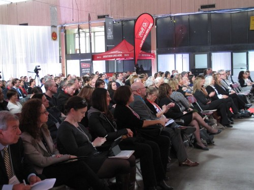 The crowd of cheese industry professionals watches as category champions are announced